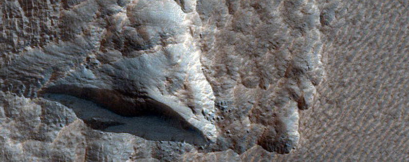 Monitoring Icy Scarp in Milankovic Crater