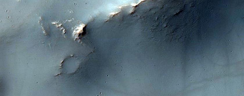 Prehnite and Phyllosilicate-Rich Terrain in Flaugergues Crater Rim