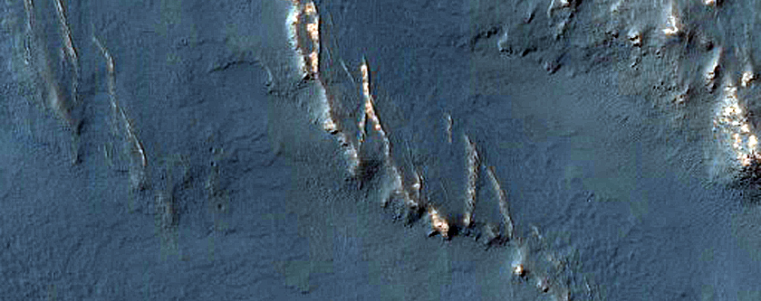 Layers in Crater near Claritas Rupes