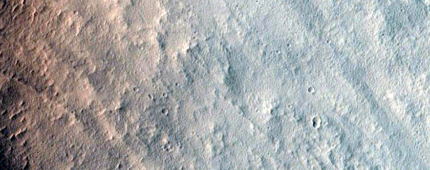 Characterizing Impact-Related Flow Features near Canala Crater