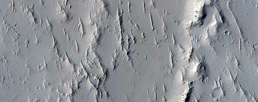 Mare-Type Ridge Intersected by Crater in Intercrater Terrain