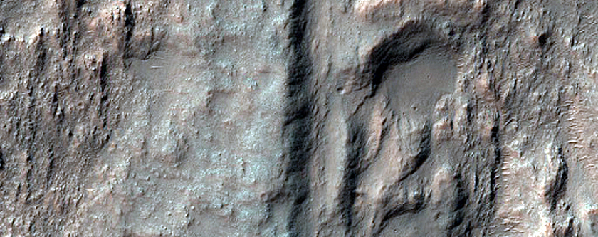 Crater Floor Mound Located at Junction of Linear Ridges