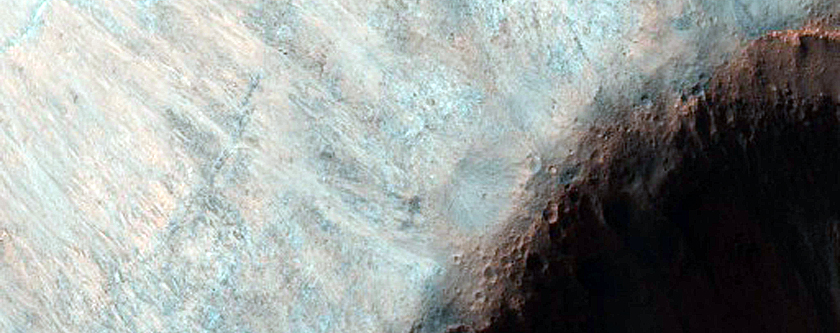 Possible Phyllosilicate-Rich Outcrop in Walls South of Aurorae Chaos