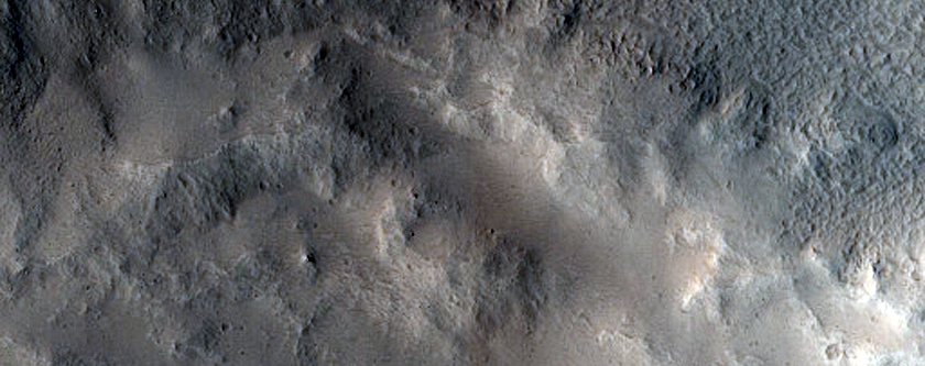 Small Lobe of Glacial Cover on Fresh Impact Crater