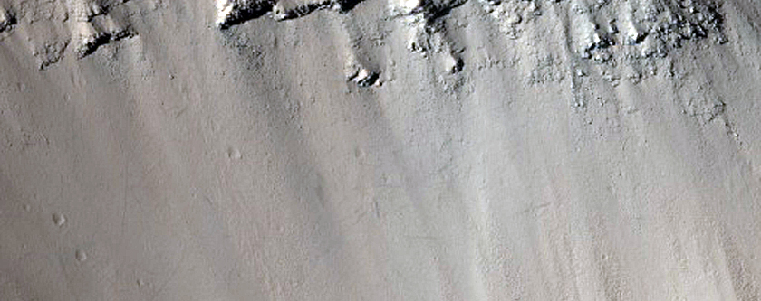 Collapse Pit in Graben with Ice Fill