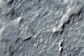 Cryptic Terrain Margin Monitoring near Promethei Rupes