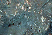 Western Portion of Well-Exposed 6-Kilometer Diameter Crater in Ladon Valles