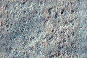 Ice-Rich Scarp Hosting Mid-Latitude Mantle Materials