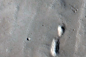 Fresh Crater with Bedrock Exposure and Glacial Deposit near Tractus Fossae