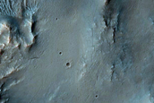 Central Features in Large Impact Crater
