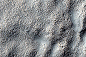 Possible Mountain Glacier Features near Reull Vallis