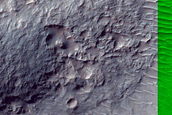 Crater with Central Structure in Ladon Valles Basin