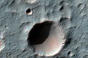 Light Toned Material on Crater Floor in Tyrrhena Terra