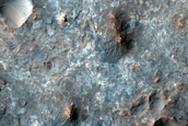 Mawrth Vallis Dark-Toned Cap Associated with Well-Preserved Crater Ejecta